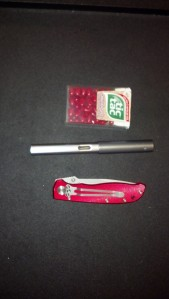 folding knife and tic tacs for scale. No idea why I picked these items.