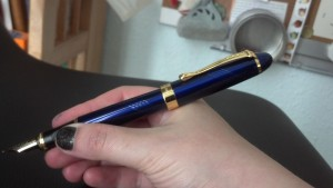Pen in hand with cap on back. I absolutely can not write with the pen in this configuration because of the weight.