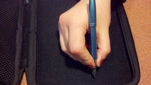 Pen in hand with cap